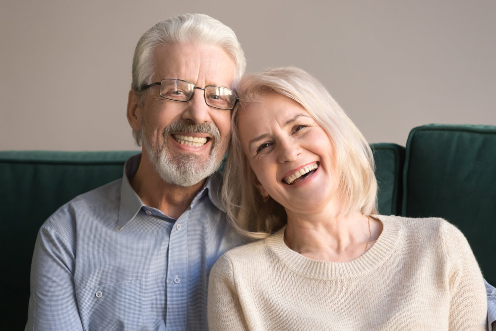 elderly couple receives new dental crowns